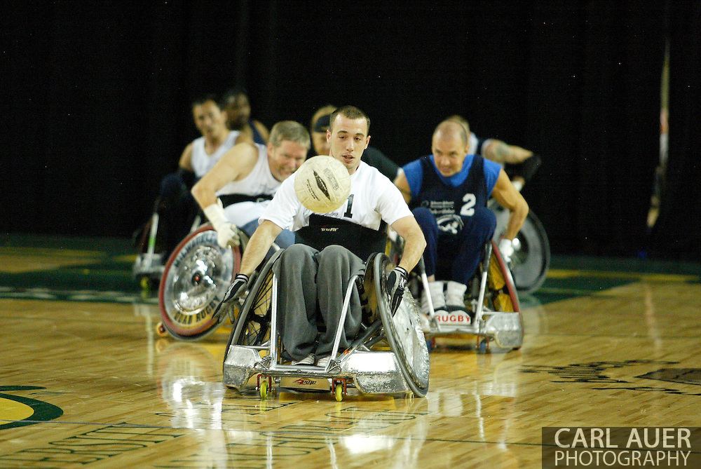 July 7th, 2006: Anchorage, AK - Thomas Durbin chases after a bad pass as White defeated Blue in the gold medal game of Quad Rugby at the 26th National Veterans Wheelchair Games.