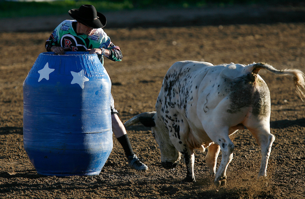 "061308-Evergreen, CO-fridaynightbulls-Bull fighter Joe Butler squares off against a bull during the ""Friday Night Bulls"" event Friday, June 13, 2008 at the Evergreen Rodeo Grounds..Photo By Matthew Jonas/Evergreen Newspapers/Photo Editor"