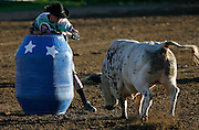 """061308-Evergreen, CO-fridaynightbulls-Bull fighter Joe Butler squares off against a bull during the """"Friday Night Bulls"""" event Friday, June 13, 2008 at the Evergreen Rodeo Grounds..Photo By Matthew Jonas/Evergreen Newspapers/Photo Editor"""