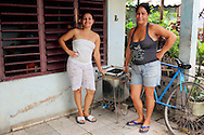 Women with washing machine in Rafael Freyre, Holguin, Cuba.