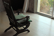 comfortable rocking chair in front of window