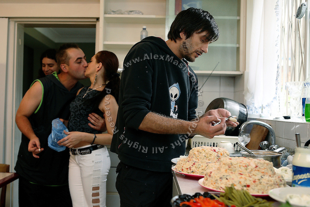 Nego, 31, is kissing his girlfriend, Daniela, 26, (right) in the kitchen of the Wildwood Road mansion while Lulu, 33, from Romania, (right) is cooking a meal, on Saturday, Aug. 18, 2007, in Hampstead, London, England. Situated opposite Hampstead Heath, North London's green jewel the average price for properties on this road reaches £ 2,500,000. Million Dollar Squatters is a documentary project in the lives of a peculiar group of squatters residing in three multi-million mansions in one of the classiest residential neighbourhoods of London, Hampstead Garden. The squatters' enthusiasm, their constant efforts to look after what has become their home, their ingenuity and adventurous spirit have all inspired me throughout the days and nights spent at their side. Between the fantasy world of exclusive Britain and the reality of squatting in London, I have been a witness to their unique story. While more than 100.000 properties in London still lay empty to this day, squatting provides a valid, and lawful alternative to paying Europe's most expensive rent prices, as well as offering the challenge of an adventurous lifestyle in the capital.