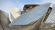 Glass 'sails' and white 'iceberg' of the Fondation Louis Vuitton, an art museum and cultural centre designed by Frank Gehry, b. 1929, and built 2008-14, next to the Jardin d'Acclimatation in the Bois de Boulogne, in the 16th arrondissement of Paris, France. The building resembles the sails of a boat and houses 11 galleries, an auditorium seating 350 and roof terraces. Picture by Manuel Cohen