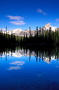 Morning light on Cathedral Peak reflected in Lake O'Hara, Yoho National Park, British Columbia, Canada