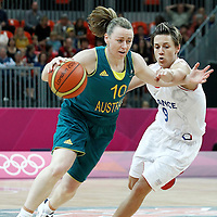 30 July 2012: Kristi Harrower of Australia drives past Celine Dumerc of France during the 74-70 Team France overtime victory over Team Australia, during the women's basketball preliminary, at the Basketball Arena, in London, Great Britain.