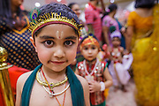 10 AUGUST 2012 - PHOENIX, AZ:  A boy dressed as the Lord Krishna during the celebration of Janmashtami at Ekta Mandir, a Hindu temple in central Phoenix. Janmashtami is the Hindu holy day that celebrates the birth of Lord Krishna. Hindu communities around the world celebrate the holy day. In Arizona, most of the Hindu temples in the Phoenix area have special celebrations of the day.  PHOTO BY JACK KURTZ