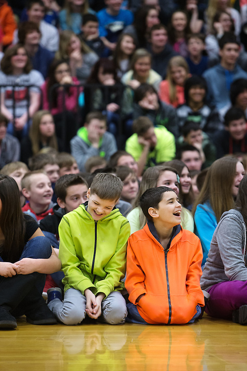 GABE GREEN/Press<br /> <br /> Caden Hess 12, left, and Cole Stephens 12 crack up over a joke told by motivational speaker Stu Cabe Tuesday at Woodland Middle School during an assembly about bullying.