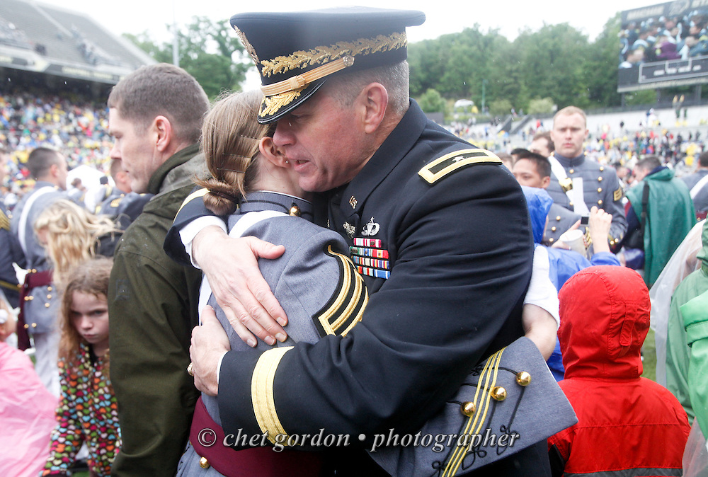 Army 2nd. Lieutenant Cory Trainor (left) of Cornwall, NY hugs her father, Brigadier General Tim Trainor (right) during the 2013 Graduation and Commissioning Ceremony in Michie Stadium at the United States Military Academy in West Point, NY on Saturday, May 25, 2013. Brigadier General Trainor is the Academic Dean of West Point. The Secretary of Defense Chuck Hagel delivered the graduation address as 1,007 cadets were commissioned as 2nd. Lieutenants in the U.S. Army.  CHET GORDON/Times Herald-Record