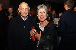 JOAN & SIDNEY BURNSTEIN of Brown's at the launch party for 'The London Look - Fashion From Street to Catwalk' held at the Museum of London, London Wall, Londom EC2 on 28th October 2004<br />