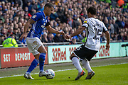 Lee Peltier of Cardiff City is challenged by Wayne Routledge of Swansea City during the EFL Sky Bet Championship match between Cardiff City and Swansea City at the Cardiff City Stadium, Cardiff, Wales on 12 January 2020.