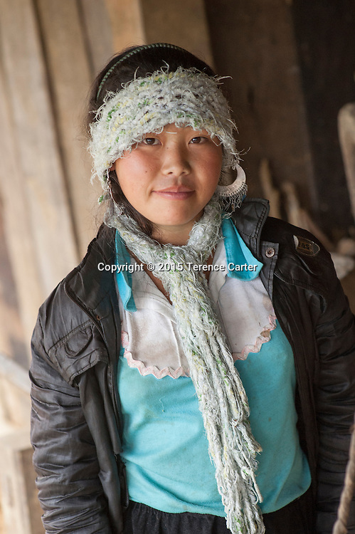A hilltribe girl outside her home in the hills above Sapa, Vietnam.