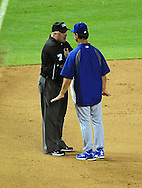 Aug. 6 2011; Phoenix, AZ, USA; Los Angeles Dodgers manager Don Mattingly talks with third base umpire Brian O'Nora during the ninth inning against the Arizona Diamondbacks at Chase Field. The Dodgers defeated the Diamondbacks 5-3.  Mandatory Credit: Jennifer Stewart-US PRESSWIRE..