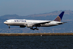 Boeing 777-222 (N771UA) operated by United Airlines landing at San Francisco International Airport (KSFO), San Francisco, California, United States of America