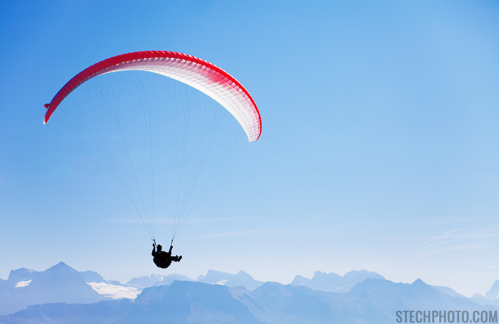 A man paragliding in the Swiss Alps near Mount Rigi.<br /> <br /> + ART PRINTS +<br /> To order prints or cards of this image, visit:<br /> http://greg-stechishin.artistwebsites.com/featured/paraglider-1-greg-stechishin.html