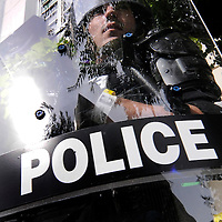 "A Police officer watches  ""The People's March to the G20"" through his riot shield as it makes it way peacefully through the street of downtown Pittsburgh, Pennsylvania on September 25, 2009.   Pittsburgh is the host city for the two day  G20 Summit of world leaders.     UPI /Archie Carpenter"