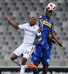 Cape Town-181002- Cape Town City Mpho Matsi  challenges Gift  Motupa  of Bidvest Wits in a PSL clash at Cape Town Stadium.Cape town City come to this game with high confidence after winning the MTN 8 cup over the weekend,while Wits will be fighting for the the top spot they have lost after some poor display in their last two games.Photographs:Phando Jikelo/African News Agency/ANA