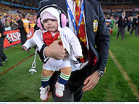 6 July 2013; Sadie O'Driscoll in the arms of her father Brian following the British & Irish Lions victory. British & Irish Lions Tour 2013, 3rd Test, Australia v British & Irish Lions. ANZ Stadium, Sydney Olympic Park, Sydney, Australia. Picture credit: Stephen McCarthy / SPORTSFILE