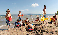 """(Karen Bobotas/for the Laconia Daily Sun)A great day to """"beat the heat""""  and enjoy the lake at Ellacoya State Beach Friday, July 22, 2011."""