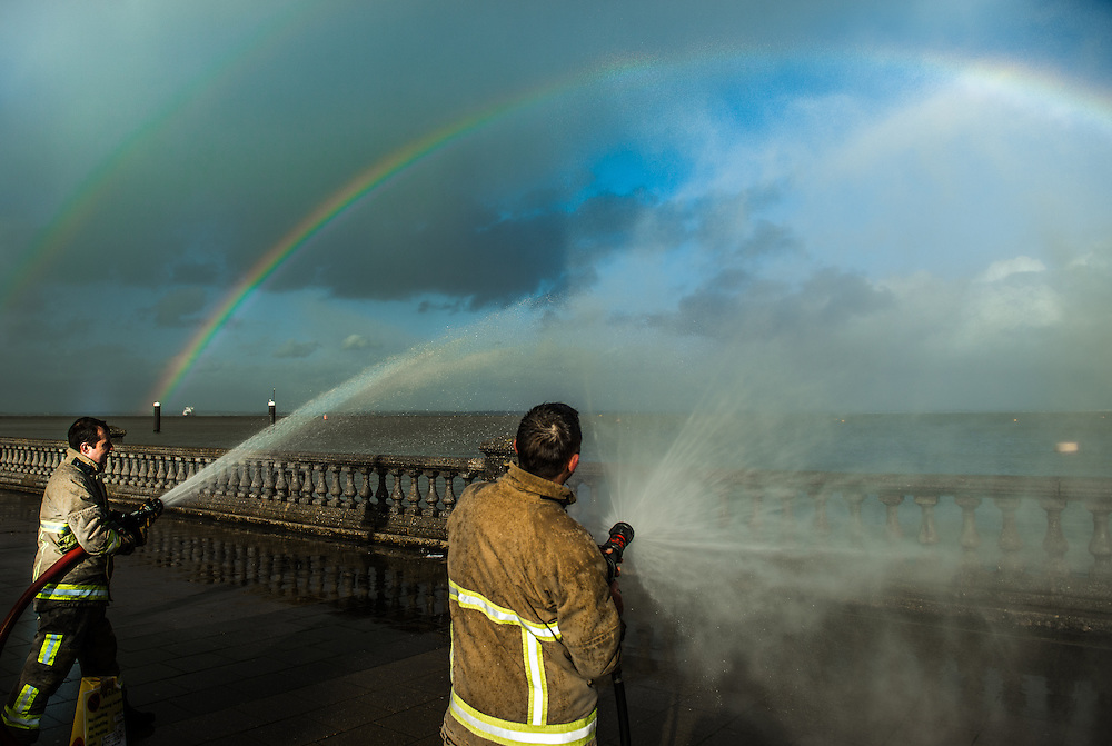 Cowes firemen create rainbow at the RNLI Lifeboat SOS day, Cowes Parade