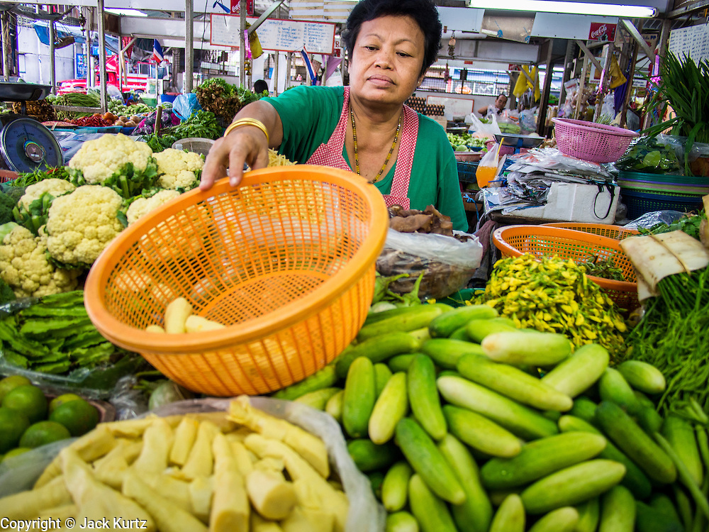 18 JULY 2013 - BANGKOK, THAILAND:  A produce vendor in the Onnuch (also known as On Nut) Wet Market off of Sukhumvit Soi 77 in Bangkok.       PHOTO BY JACK KURTZ