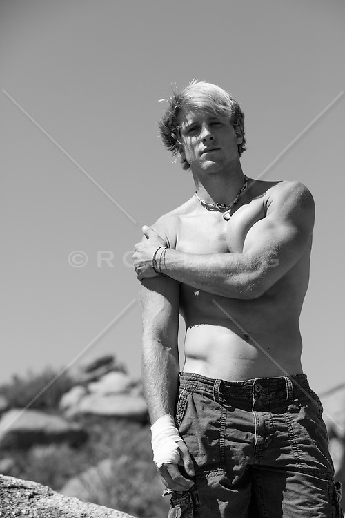shirtless man with a bandage on his hand