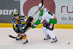 Manuel Ganahl (Moser Medical Graz 99ers, #71) vs Ales Music (HDD Tilia Olimpija, #16) during of ice-hockey match between Moser Medical Graz 99ers and HDD Tilia Olimpija in 11th Round of EBEL league, on October 14, 2011 at Eisstadion Graz-Liebenau, Graz, Austria. (Photo By Matic Klansek Velej / Sportida)