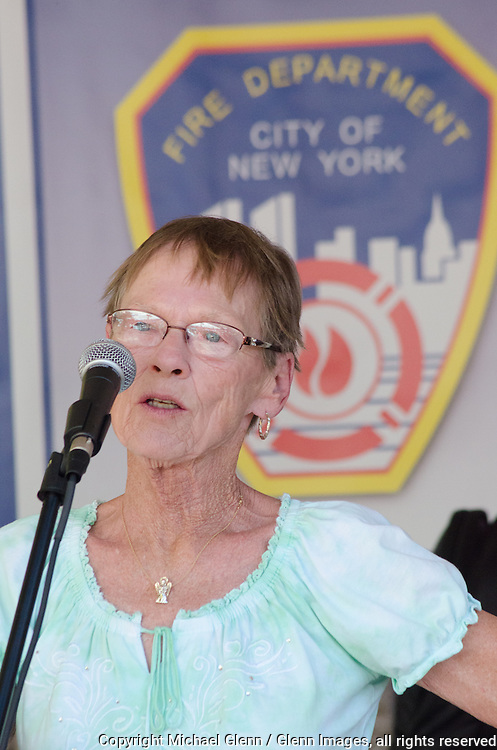 19 Sep 2015 Staten Island, New York US // Iris Martinson speaks to members and families come at the 8th annual Lt. John Martinson Memorial Picnic at the Hillside Swim Club //  Michael Glenn  /   for the FDNY