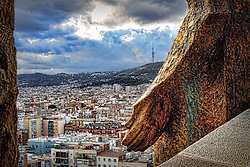 View of Barcelona from the Sacred Family Cathedral, with a detailed view of architectural details in the foreground.
