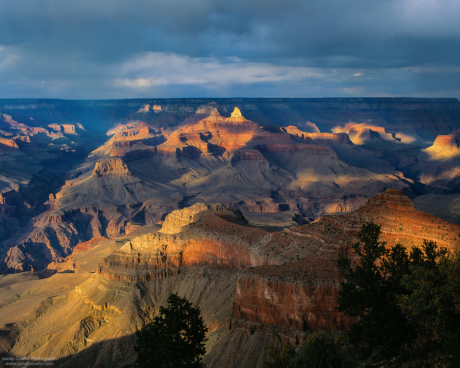 Zoroaster Temple highlighted at sunset from Mather Point on the South Rim of the Grand Canyon in Arizona
