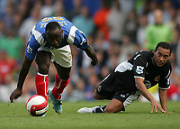 Photo: Lee Earle.<br /> Portsmouth v Wigan Athletic. The Barclays Premiership. 09/09/2006. Portsmouth's Lomana tresor LuaLua (L) and Denny Landzaat eye the ball.