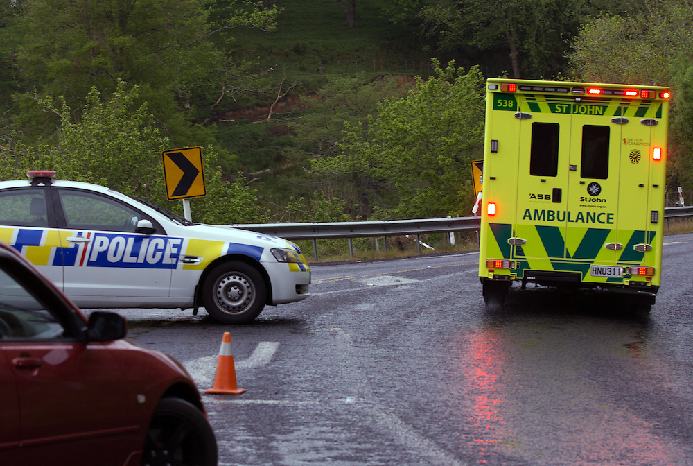 Police have closed Welcome Bay Road after one man died and another has been seriously injured after a mobile library bus and a car crashed near Faith Bible College, Tauranga, New Zealand, Wednesday, October 22, 2014.Credit:SNPA / Cameron Avery