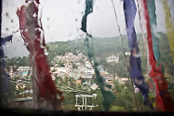 View of rainy McLeod Ganj is seen in Dharamsala, India, where the Dalai Lama settled after fleeing Tibet in 1959 after a failed uprising against Chinese rule, May 27, 2009.