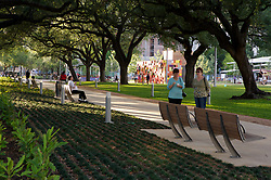 Stock photo of people enjoying the park's walking paths