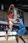 Cal State Fullerton Titans forward Davon Clare (5) scores against San Diego Toreros guard Marion Humphrey (0) during an NCAA basketball game, Wednesday, Dec. 11, 2019, in Fullerton, Calif. San Diego defeated CSUF 66-54. (Jon Endow/Image of Sport)