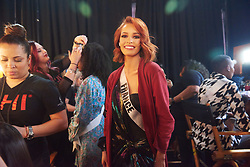 December 8, 2019, Atlanta, Georgia, USA: Maëva Coucke, Miss France 2019 gets hair done by a stylist from Farouk Systems, the Makers of CHI & Biosilk and makeup done by an OP Cosmetics artist backstage during The Miss Universe Competition telecast, held at Tyler Perry Studios. Contestants from around the globe have spent the last few weeks touring, filming, rehearsing and preparing to compete for the Miss Universe crown. (Credit Image: © Benjamin Askinas/Miss Universe Organization via ZUMA Wire)