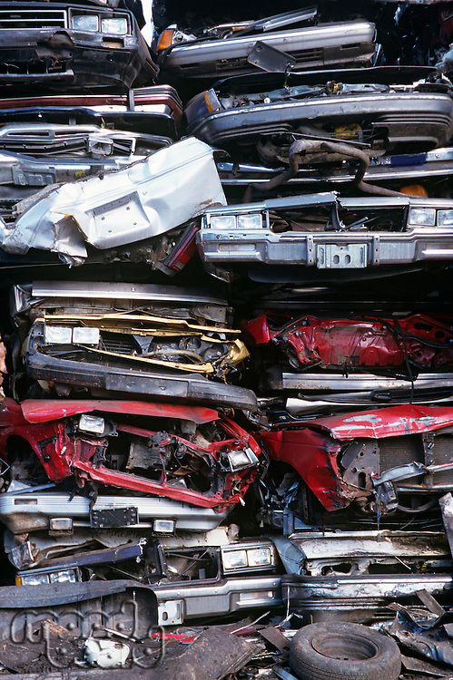 Pile of crushed cars in junkyard full frame