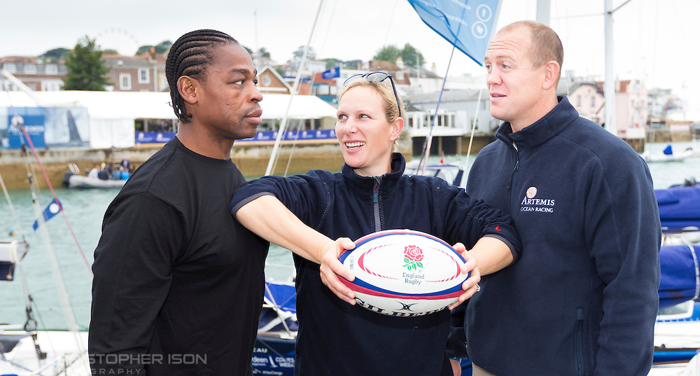 Zara Phillips keeps rugby rivals Serge Betsen and her husband Mike Tindall apart ahead of the Artemis Challenge at Aberdeen Asset Management Cowes Week.<br /> The former France and England players faced off ahead of a &pound;10,000 charity yacht race around the Isle of Wight today.<br /> Picture date Thursday 13th August, 2015.<br /> Picture by Christopher Ison. Contact +447544 044177 chris@christopherison.com<br /> EVENT ENQUIRIES: Camilla Green camilla@camillagreen.co.uk <br /> +44 7970 746482