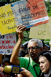 October 1, 2018 - Valencia, Carabobo, Venezuela - October 01, 2018. Protest of professors, employees and general staff of the University of Carabobo was held in the street infront of the  headquarters of the dean of that house of studies in order to protest the deterioration suffered in recent months by the economic measures implemented by President Nicolas Maduro, since the meritocratic salary was lost and everyone from the cleaning staff to the teacher with more years of services earn the same salary, decreed in sovereign Bolivares 1. 800, or before Bolivares fuertes 180.000.000, oo (Approximately $ 15, oo) monthly The benefits of social security and bonuses are lost, said the protesters who could be specifying a general strike in the next few days. The poster says '' .Face UC (faculty of economic sciences of the University of Carabobo) does not bend ''. In Valencia, Carabobo state. Photo: Juan Carlos Hernandez (Credit Image: © Juan Carlos Hernandez/ZUMA Wire)