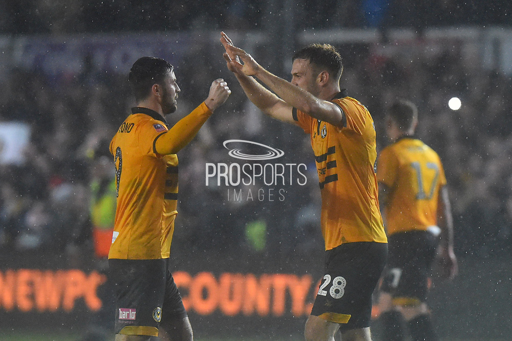 Padraig Amond (9) of Newport County and Mickey Demetriou of (28) of Newport County celebrates the 2-0 win at full time during the The FA Cup match between Newport County and Middlesbrough at Rodney Parade, Newport, Wales on 5 February 2019.