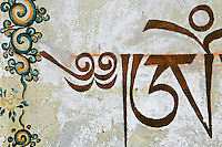 China, Wutai Shan, 2008. A detail of the Tibetan script and elaborate painting that ornaments the pagoda at Longquan Temple south of Taihuai town.