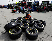 A race crew member prepares tires before a NASCAR practice run at Kansas Speedway in Kansas City, Kan., Saturday, May 11, 2018. (AP Photo/Colin E. Braley)