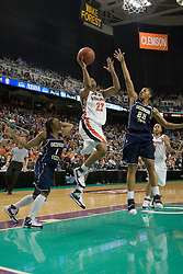 Virginia guard Monica Wright (22) leaps past Georgia Tech forward Alex Montgomery (22).  The #4 seed/#25 ranked Virginia Cavaliers women's basketball team defated the #5 seed Georgia Tech Yellow Jackets 52-43 in the quarterfinals of the 2008 ACC Women's Basketball Tournament at the Greensboro Coliseum in Greensboro, NC on March 7, 2008.