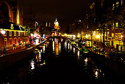 Amsterdam canal at night.