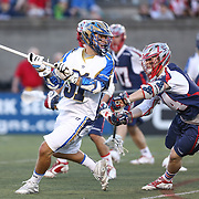 Joe Cummings #91 of the Charlotte Hounds controls the ball during the game at Harvard Stadium on May 17, 2014 in Boston, Massachuttes. (Photo by Elan Kawesch)