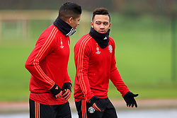 Memphis Depay of Manchester United talks with Marcos Rojo - Mandatory byline: Matt McNulty/JMP - 07966386802 - 24/11/2015 - FOOTBALL - Aon Training Complex -Manchester,England - UEFA Champions League
