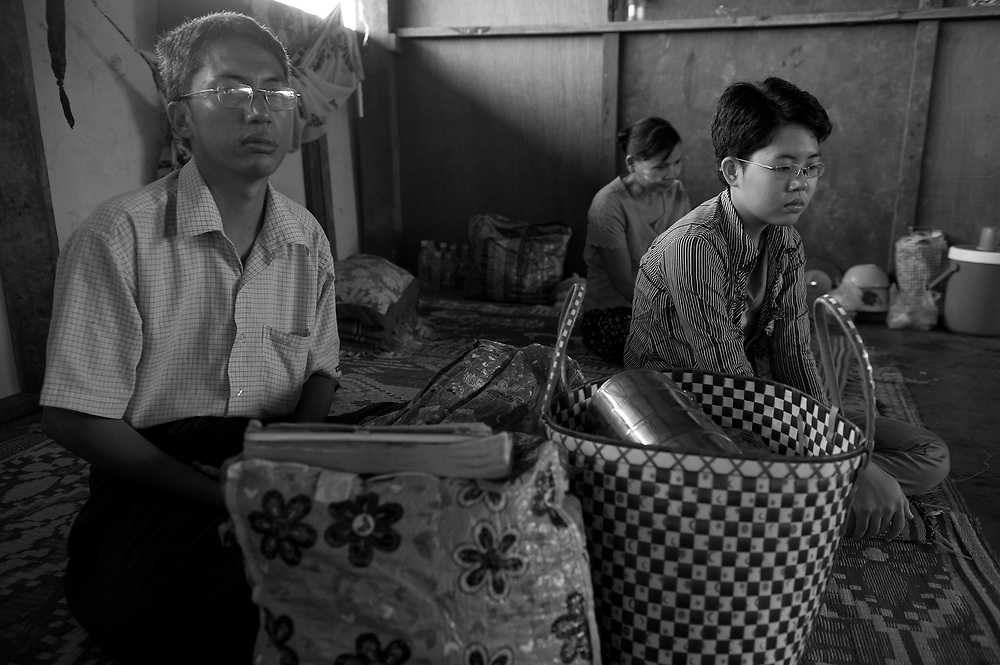 Ma Wint War Thaw, an 18 year old, suffering with Arterio venus malformation. Ma Wint War Thaw was having treatment in Burma that ran out when Doctors told her they didn't have the resources, telling her she should go to a foreign hospital. Her father sold up family belongings to make the trip to the clinic. Here they wait patiently for the arrival of the vehicle that will take them to Chiang Mai for treatment..The Mae Tao Clinic (MTC), founded and directed by Dr. Cynthia Maung, provides free health care for refugees, migrant workers, and other individuals who cross the border from Burma to Thailand in search of of medical treatment.