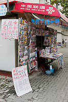 news stand in shanghai china with local newspapers and magazines