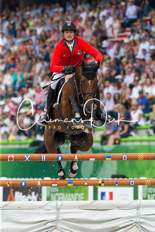 Steve Guerdat, (SUI), Nino Des Buissonnets - World Champions, - Second Round Team Competition - Alltech FEI World Equestrian Games&trade; 2014 - Normandy, France.<br /> &copy; Hippo Foto Team - Leanjo De Koster<br /> 25/06/14