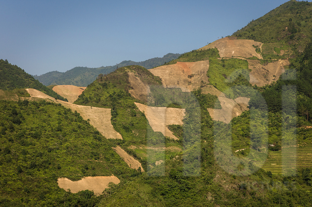 Patches of cleared forest along a hillside, between Nghia Lo and Tram Tau, in preparation for terraced fields, Yen Bai Province, Northern Vietnam, Southeast Asia