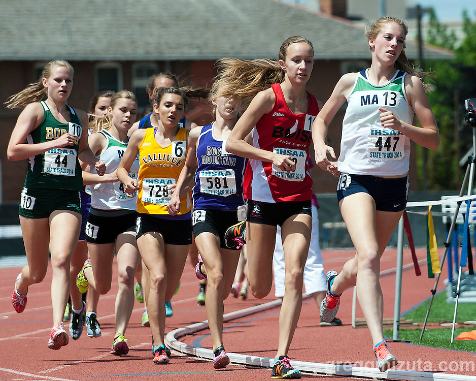 The lead pack (Front to back: Samantha McKinnon, Emily Hamlin, Sara Musselman, Mikayla Malaspina, Erin Hagen and Sara Christianson) during the first lap of the 5A State Track &amp; Field Championships 1600 meter final at Dona Larsen Park, Boise, Idaho on May 17, 2014. <br />
